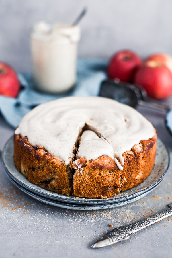 Apple and Almond Cake with creamy cashew frosting on a plate, maja brekalo