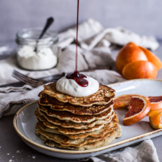 Fluffy Vegan Pancakes, healthy and wheat free, on a plate with a drizzle of maple syrup Maja Brekalo