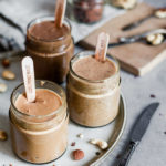 Hazelnut, cashew and Almond butters in jars on a plate, Maja Brekalo