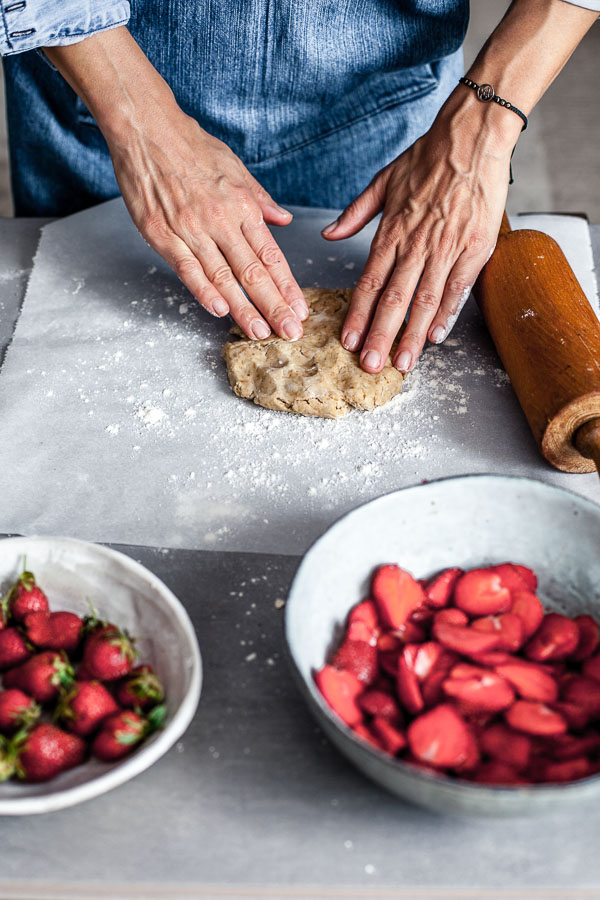 Making of strawberry galette, flattening the dough, Maja brekalo
