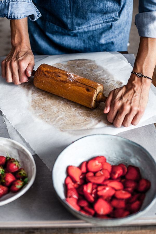 Making of strawberry galette, rolling the dough in between 2 sheets of parchment paper, Maja Brekalo