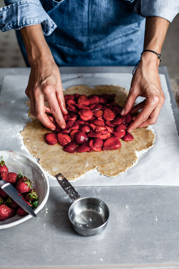 Making of strawberry galette, placing strawberries on rolled out pastry, Maja Brekalo