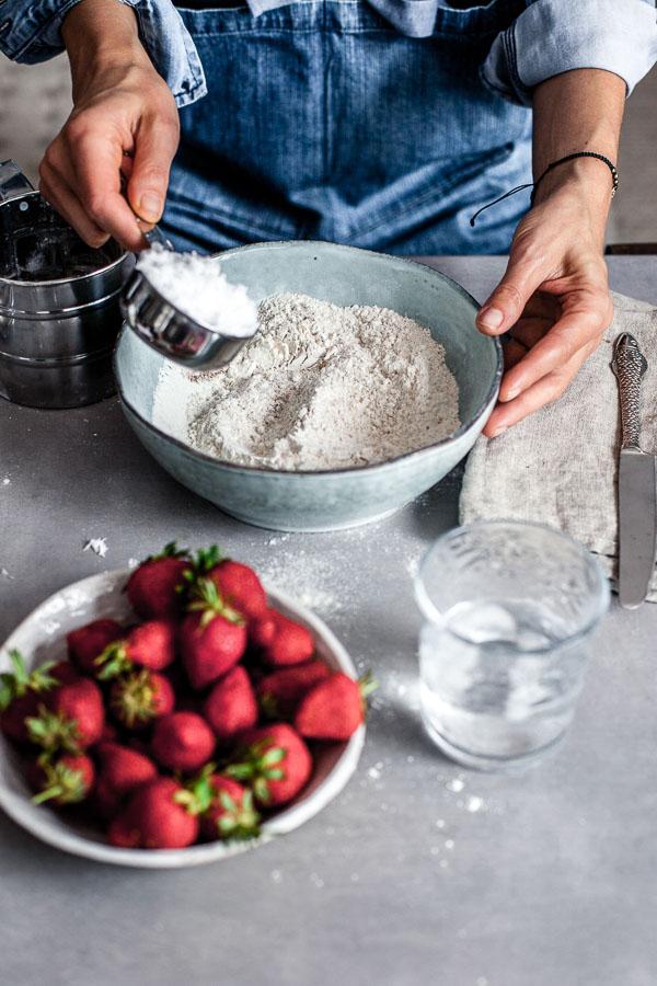 Making of strawberry galette - adding coconut oil to flour, Maja brekalo