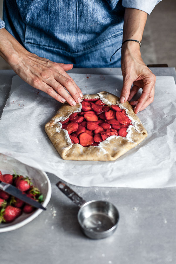 Making of strawberry galette, Puling up the edges of pastry over filling, Maja Brekalo