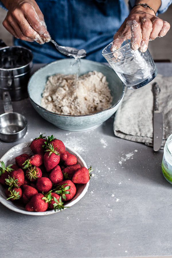 Making of strawberry galette,adding ice water to flour and coconut oil, Maja brekalo