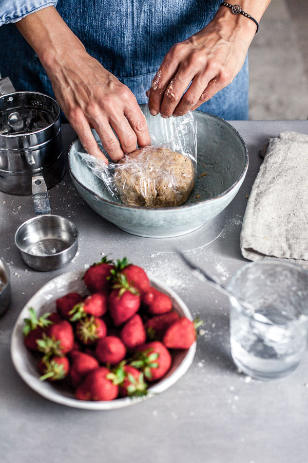 Making of strawberry galette, wrapping the dough into a cling foil, Maja brekalo