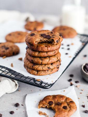 A stack of Vegan Flourless Chocolate Chip Cookies on a cooling rack, Maja Brekalo