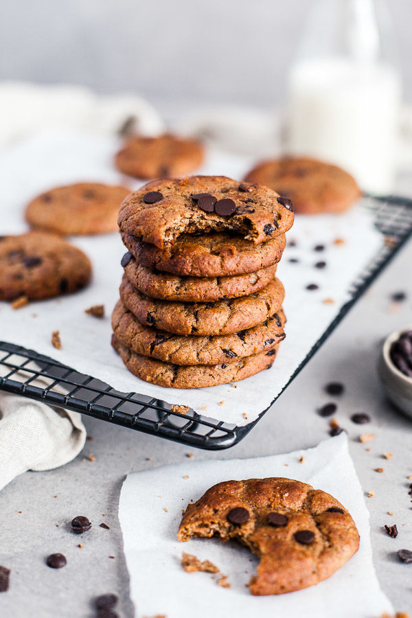 A stack of Vegan Flourless Chocolate Chip Cookies on a cooling rack, Maja Brekalo