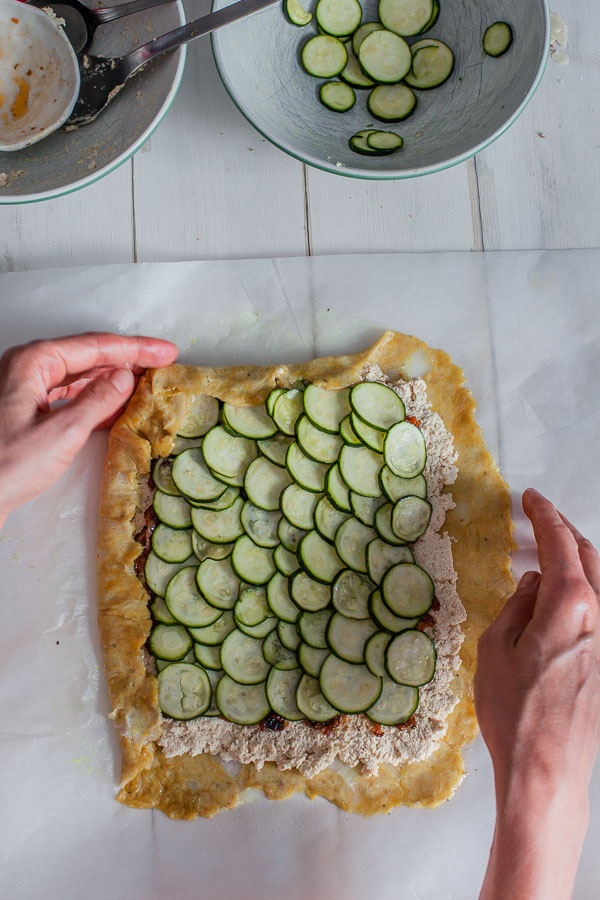 Assembling caramelised onion zucchini galette