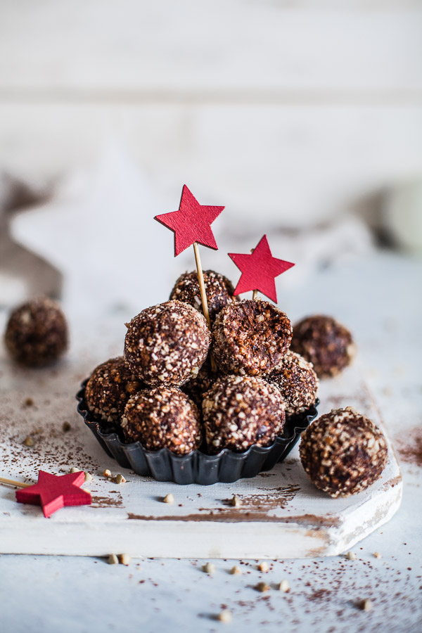 Hazelnut chocolate bliss balls decorated with red stars