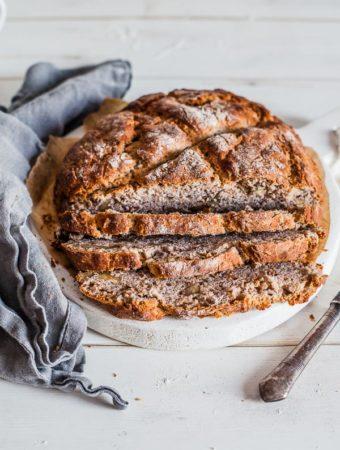 Buckwheat-no-yeast-bread-on-white-round-board-maja-brekalo
