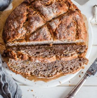 Buckwheat-soda-bread-sliced-on-white-wooden-board-maja-brekalo
