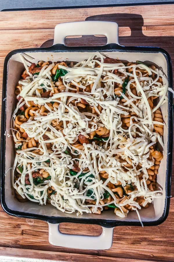 Pasta-with-beans-and-spinach-topped-with-vegan-cheese-ready-for-baking-maja-brekalo